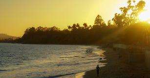 Summer sunset on the horizon across California ocean Beach. Orange yellow colors of summertime vacationland sunset in California Stock Photos