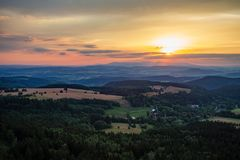 Summer sunset landscape green forest and mountains Royalty Free Stock Image