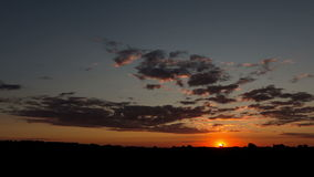 Summer sunset over the field. Time-lapse stock video footage