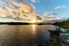 Summer sunset over the forest lake Stock Photo