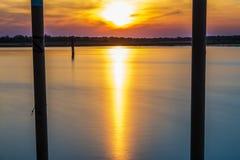 Summer twilight over the lagoon shoreline in Bibiobe, venice. Summer sunset over the lagoon water and shoreline inside Bibione, Venice stock photos