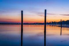 Summer twilight over the lagoon shoreline in Bibiobe, venice. Summer sunset over the lagoon water and shoreline inside Bibione, Venice royalty free stock images