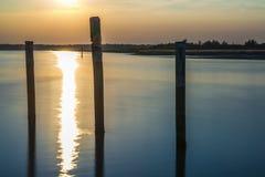 Summer twilight over the lagoon shoreline in Bibiobe, venice. Summer sunset over the lagoon water and shoreline inside Bibione, Venice stock photo