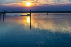 Summer twilight over the lagoon shoreline in Bibiobe, venice. Summer sunset over the lagoon water and shoreline inside Bibione, Venice stock images