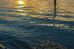 Summer twilight over the lagoon shoreline in Bibiobe, venice. Summer sunset over the lagoon water and shoreline inside Bibione, Venice stock photography