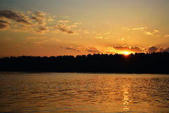 Summer sunset over the lake Royalty Free Stock Photos