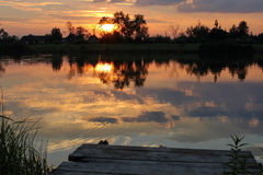 Summer sunset over the lake Royalty Free Stock Photography