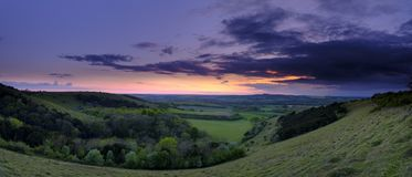Summer sunset over Meon Valley towards Beacon Hill and Old Winchester Hill, South Downs National Park royalty free stock image
