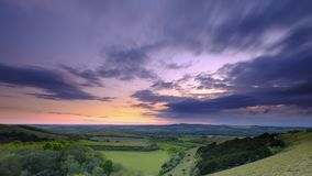 Summer sunset over Meon Valley towards Beacon Hill and Old Winchester Hill, South Downs National Park royalty free stock photo