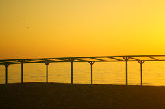 Summer sunset on the sea. The sun to set over the horizon reflected in the sea Royalty Free Stock Photography