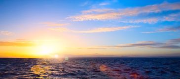 Summer sunset seascape with wide horizon of the sky and the sea. Art Summer sunset seascape with wide horizon of the sky and the sea royalty free stock photography