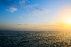 Summer sunset seascape with wide horizon of the sky and the sea. Art Summer sunset seascape with wide horizon of the sky and the sea stock photo