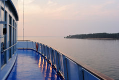 Summer sunset seen from a deck of a cruise liner Royalty Free Stock Images