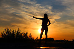 Summer sunset silhouette. And autostop Stock Image