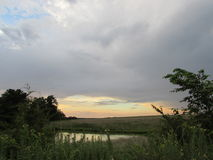 A Country Scene with Pond and Sunset Stock Photo