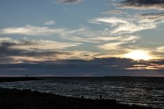 Summer sunset on the waters of the Gulf of Finland stock photography
