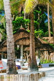 Summer sunshade and sunbed on the tropical white sand beach. nipa sunshade and bamboo sunbed Stock Photography