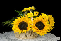 Summer Sunshine. Sunflower and daisy bouquet in a wicker basket royalty free stock images