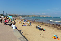 Summer sunshine Swanage beach and coast Dorset England UK with waves on the shore Royalty Free Stock Photo