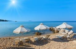 Summer sunshiny beach. Summer sunshiny sandy Platanitsi beach with sunbeds and sunshades Chalkidiki, Greece Stock Image
