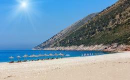 Summer sunshiny beach. Summer sunshiny beach with sunbeds and strawy sunshades Albania Royalty Free Stock Photos