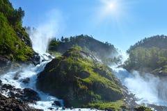 Summer sunshiny Latefossen waterfall, Norway. Summer sunshiny mountain Latefossen or Latefoss waterfall on slope Odda, Norway Stock Photos