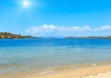 Sunshiny sea coast Sithonia, Greece. Summer sunshiny sea coast landscape Livari beach, Halkidiki, Sithonia, Greece Royalty Free Stock Photos
