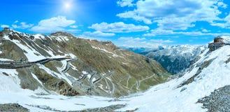Summer sunshiny Stelvio pass Italy. Summer sunshiny Stelvio pass top panorama with alpine road and snow on slope Italy Stock Photo