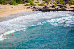 Summer Surfers at the Beach. Surfers in the blue water of Hawaii at the Makapu`u Beach Park in Kailua, Oahu stock image