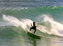 Summer Surfing. Surfer catching a wave in the Medieterranean Sea Royalty Free Stock Images