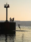 Summer swim. Children enjoy a summer's late afternoon cooling swim Stock Photography