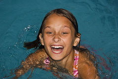 Summer Swimming Lessons. Young child training for swimming gala Royalty Free Stock Photos