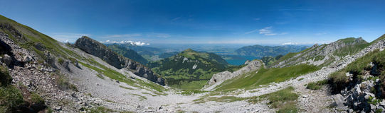 Summer in Swiss Alps. Stitched Panorama of Brisen and Klewenalp, Rigi region, Swiss Alps Royalty Free Stock Photo