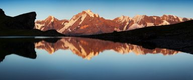 Summer in the Swiss Alps, Murren area, overlooking the Eiger, Monch and Jungfrau mountains reflected in Grauseewli Lake, stock photo