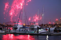 Boats at jetty with fireworks over harbor Royalty Free Stock Image