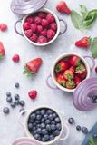 Berry fruits. Summer t background, top view of berries , smoothie ingredient, ine ceramic colored cocotte, blueberries, strawberries, raspberries, flat lay Stock Photography