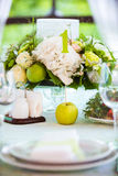 Summer table setting in green Royalty Free Stock Photo