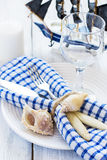 Summer table setting in marine style, decorated with shells and Royalty Free Stock Photography