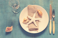 Summer table setting in marine style, tinted.  Stock Photography