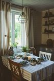 Summer table setting in natural organic style with handmade details in green and brown tones. Country living concept royalty free stock images