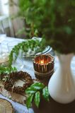 Summer table setting in natural organic style with handmade details in green and brown tones. Country living concept stock photography