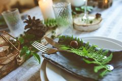 Summer table setting in natural organic style with handmade details in green and brown tones. Country living concept royalty free stock photos