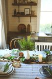 Summer table setting in natural organic style with handmade details in green and brown tones. Country living concept royalty free stock photo