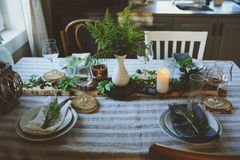 Summer table setting in natural organic style with handmade details in green and brown tones. Country living concept stock photo
