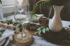 Summer table setting in natural organic style with handmade details in green and brown tones. Country living concept stock images
