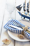 Summer table setting with sea decor on a white boards background.  Stock Photography