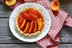 Summer tart with sweet peach Stock Photos