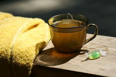 Summer tea. Terry towel, green tea and candy on the summer terrace Stock Photo