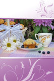 Garden tea party with blueberry muffins Stock Image