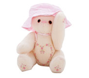 Summer teddy bear putting on a pink hat Royalty Free Stock Images